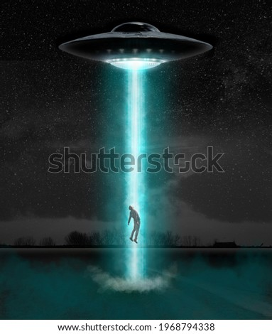 Man being abducted by UFO - alien abduction concept Royalty-Free Stock Photo #1968794338