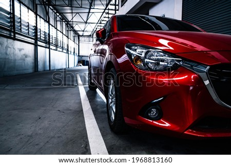 Car tail light red color on black background for customers. Using wallpaper or background for transport or automotive automobile Royalty-Free Stock Photo #1968813160