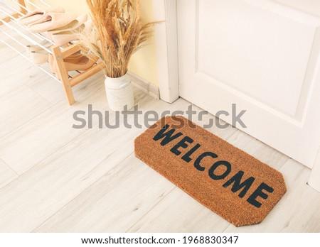 Door mat on floor in hallway Royalty-Free Stock Photo #1968830347
