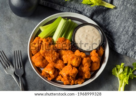 Homemade Fried Boneless Buffalo Chicken Wings with Ranch Dressing Royalty-Free Stock Photo #1968999328