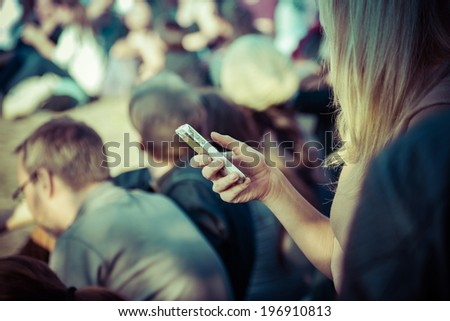 Female smartphone user in public Royalty-Free Stock Photo #196910813