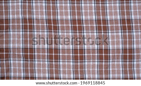 Checkered fabric with colored threads. Fabric for plaid coat and suit. Close-up. Background