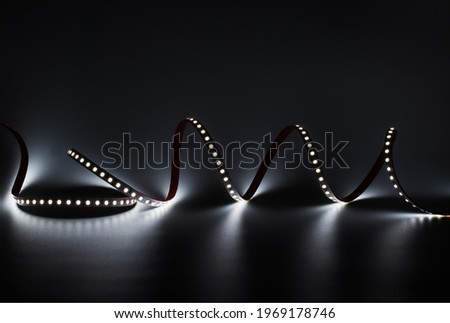 LED strip with white lighting on a dark decorative background Royalty-Free Stock Photo #1969178746
