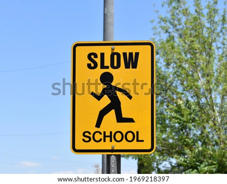 Yellow Slow School Sign With Symbol
