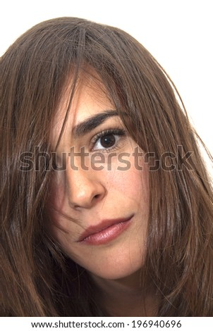 Portrait of Beautiful Young Woman With Her Hair covering her face Over White Background #196940696