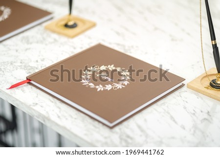 A guest signage book for blessing of wedding ceremony event with brown cover. Lovely and happiness event abstract, object photo.