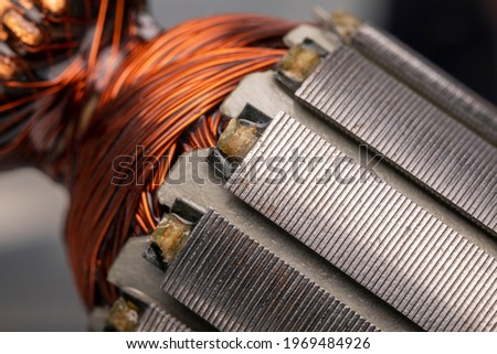 Rotor of an electric motor close up. Copper motor windings. Royalty-Free Stock Photo #1969484926