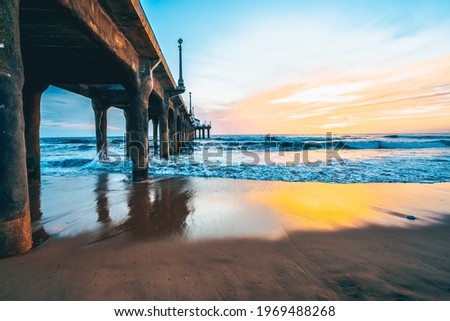 Manhattan beach pier at sunset, orange-pink sky with bright colors, beautiful landscape with ocean and sand Royalty-Free Stock Photo #1969488268