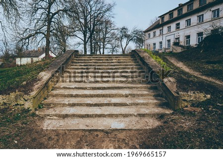 Park landscape. Stone paved stairs in park  Royalty-Free Stock Photo #1969665157