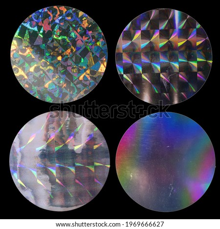 cool round metallic holo stickers on black with scratches, sticky holographic iridescent color foil tapes or snips for your design poster, sticker set. Royalty-Free Stock Photo #1969666627