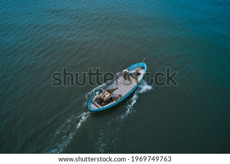 Fishing boats floating on the sea. Fishermans in boat. fishing boat sailing in open waters. man fishing on boat. sailing boat landscape Royalty-Free Stock Photo #1969749763