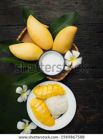 fresh ripe mango and sticky rice with coconut milk, authentic Thai dessert,Thai seasonal fruit, Royalty-Free Stock Photo #1969867588