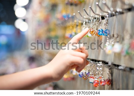 Child's hand choosing glass miscellaneous goods Royalty-Free Stock Photo #1970109244