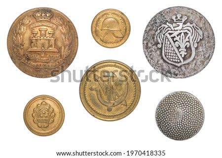 Vintage buttons isolated: British army suffolk regiment soldier's brass Gibraltar, Latvian Military, USSR communication ministry sickle hammer lightning, German tunic WW2, fireman small button. Royalty-Free Stock Photo #1970418335