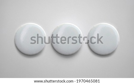 White pin button. Pin button set. Collection of realistic pin buttons. White blank badge pin brooch isolated on white background. Photo of badge.Badge Mock-up isolated on background. Royalty-Free Stock Photo #1970465081