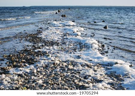 foam at rocky seaside #19705294