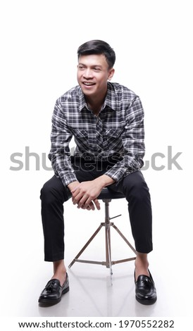 Man Sitting on Chair HD Stock Images