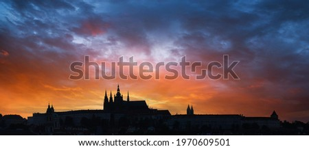 Beautiful sunset sky with the silhouette of an ancient castle, twilight sky background.