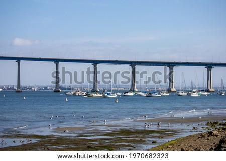 Sailboats anchored by the Coronado Bay Bridge.