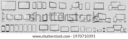 Set mockups of technology devices with empty display, device screen mockup collection, big realistic set mock up TV, computer, laptop, tablet, smartphone and watch with shadow. Royalty-Free Stock Photo #1970710391