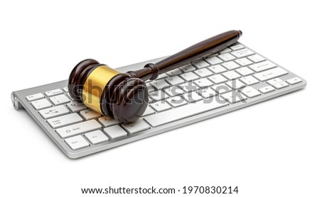 Computer keyboard with judge gavel. Isolated on white.