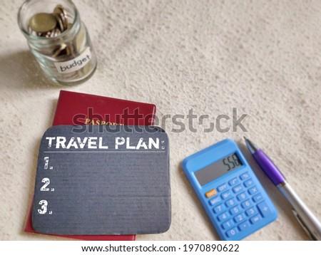 Economy Concept. TRAVEL PLAN text background. Stock photo.