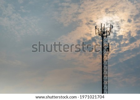 Technology on the top of the telecommunication GSM (5G,4G,3G) tower.Cellular phone antennas on a building roof.Telecommunication mast television antennas.Receiving and transmitting stations Royalty-Free Stock Photo #1971021704