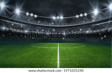 textured soccer game field with neon fog - center, midfield Royalty-Free Stock Photo #1971035240