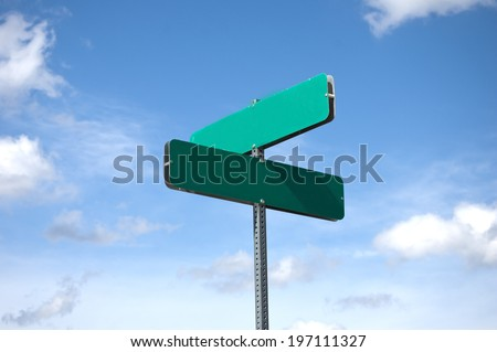 blank street sign against sky and clouds