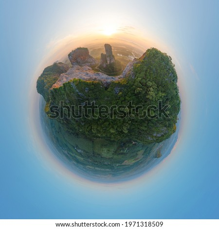Little planet 360 degree sphere. Panorama of Khao Kuha at Songkhla. Mountain hill with green forest trees. Nature landscape background in Thailand. Huangshan mountain. Royalty-Free Stock Photo #1971318509