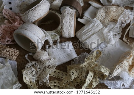 vintage lace, white sewing ribbon, nature background Royalty-Free Stock Photo #1971645152