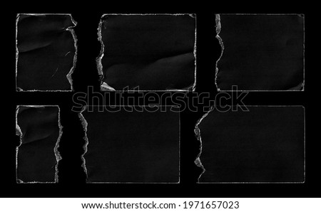 Set of Black Torn Ripped Paper Pieces Edges Cards isolated on Black Background. Cardboard Overlay Texture.  Royalty-Free Stock Photo #1971657023