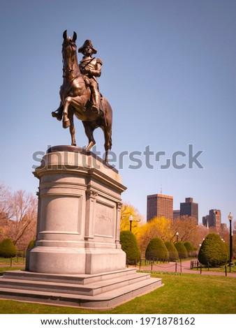 George Washington Statue in Boston Public Garden. The First American President. General Washington on Horseback. Diagonal Low Angle View.