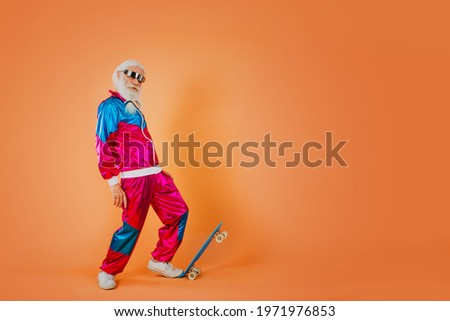 Fashionable grandfather posing with funny futuristic clothes. Senior man portraits on colored background