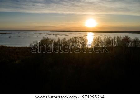 Nice landscape with sunset on lake Royalty-Free Stock Photo #1971995264