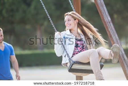 Man swinging his girl in a park #197218718
