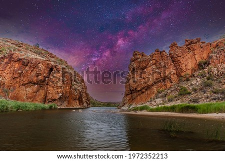 Milky Way galaxy above Glen Helen Gorge Finke River passage in West MacDonnell National Park in Australia's Northern Territory with beautiful light from a clear starry sky Royalty-Free Stock Photo #1972352213