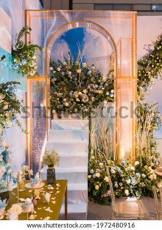 Wedding archway with flowers arranged for a wedding ceremony Royalty-Free Stock Photo #1972480916