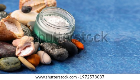 Natural supplement. Marine collagen powder on the background of stones. Healthy lifestyle concept. Hydrolyzed collagen in a glass jar. Copy space. Royalty-Free Stock Photo #1972573037