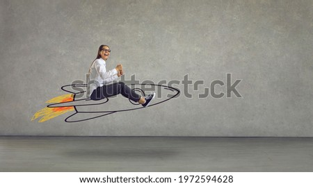 Side view of excited smiling laughing woman flying in air riding hand drawn cartoon doodle rocket with burning blast off flame. Using creative power, reaching success, achieving business goal concept