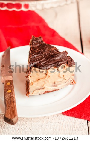 Dark chocolate cake with Coffee slice with chocolate buttercream frosting on a white plate.Selective focus. Royalty-Free Stock Photo #1972661213