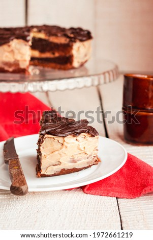 Dark chocolate cake with Coffee slice with chocolate buttercream frosting on a white plate.Selective focus. Royalty-Free Stock Photo #1972661219
