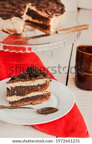 Dark chocolate cake with Coffee slice with chocolate buttercream frosting on a white plate.Selective focus. Royalty-Free Stock Photo #1972661231