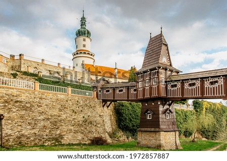 Old carved wooden Jurkovic bridge with charming castle tower in Nove Mesto nad Metuji, pearl of Eastern Bohemia, Czech Republic.Czech renaissance chateau. Popular tourist destination.Fairy tale castle Royalty-Free Stock Photo #1972857887