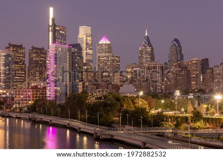 Philadelphia Downtown skyline at Night with the Schuylkill river. Beautiful Sunset Light. Schuylkill River Trail in Background. City skyline glows under the beautiful sunset light. PA, USA.