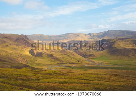 Rugged mountain Icelandic terrain in rural countryside landscape and valley in Hengill,  Iceland. Royalty-Free Stock Photo #1973070068