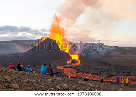 GELDINGADALIR, ICELAND - MAY 11, 2021: A small volcanic eruption has started at the Reykjanes peninsula. The event has attracted thousands of visitors who have braved a daring hike to the crater.
