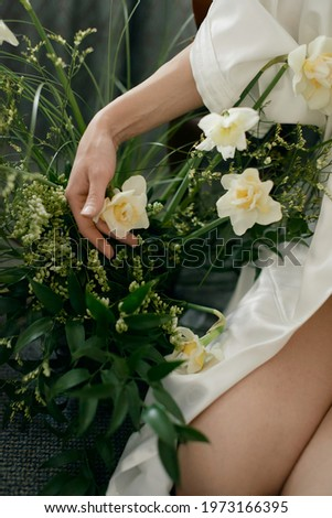 Beautiful bride accessories. Wedding details. Bouquet. A lot of  yellow flowers.  Earrings with pearls. Classic style hotel. Spring mood.  Fashionable and expensive decor. Sensitive and nice pictures
