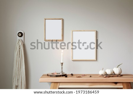 Two thin wood frames mockup. 8x10 and 11x14 sizes. Bohemian style props, decorated for fall.