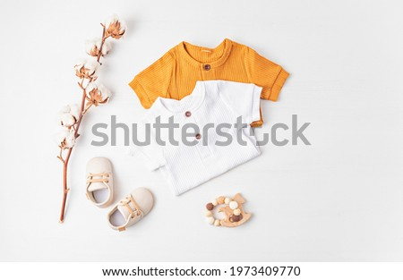 Gender neutral baby garment and accessories. Organic cotton clothes, newborn fashion Royalty-Free Stock Photo #1973409770